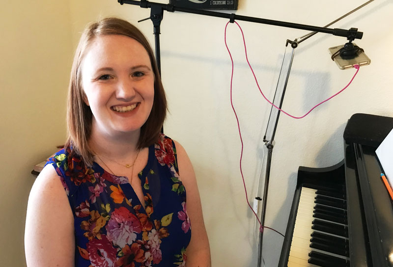 Teacher at piano for online music lessons