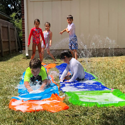 Students at elementary camp playing water games outside